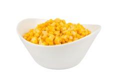 Geel graan in een kom stock fotografie
