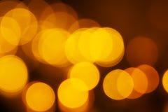 Geel licht bokeh bij nacht voor achtergrond stock foto's
