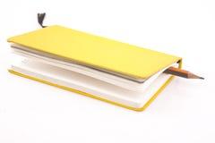 Geel notitieboekje Stock Fotografie