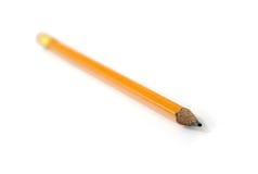 Geel potlood op witte achtergrond stock foto's