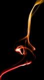 Geel-rode rook op zwarte Royalty-vrije Stock Foto's