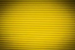Geel rollend blind voor achtergronden stock afbeelding