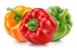Geel, rood en groene paprika's op een witte achtergrond worden geïsoleerd die Stock Afbeelding