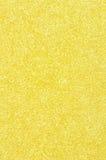 Geel schitter textuurachtergrond Stock Foto's
