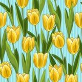 Geel tulpen naadloos patroon, blauwe achtergrond Royalty-vrije Stock Foto's