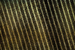 Geelachtige zwarte de textuurachtergrond van de grungestof Stock Fotografie
