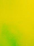 Geelgroene metaaltextuur met een ruwheid en dalingen van verfoppervlakte De stedelijke achtergrond van Grunge Stock Foto's