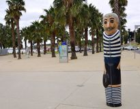 Wood sailor bollards in Geelong along the baywalk. All made by Jan Mitchell and represent a chr stock photos