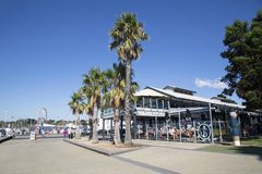 Geelong Promenade with street cafe and summer blue skies. Geelong, Australia: April 03, 2017: Wharf Shed Cafe is an informal venue with huge windows and Stock Images