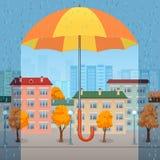 Geeloranje paraplu over de stad Stock Afbeeldingen