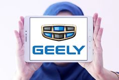 Geely automotive manufacturing company logo. Logo of Geely company on samsung tablet holded by arab muslim woman. Geely is a Chinese multinational automotive Stock Photo