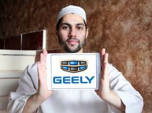 Geely automotive manufacturing company logo. Logo of Geely company on samsung tablet holded by arab muslim man. Geely is a Chinese multinational automotive Stock Photography