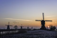 Warm and frozen windmill sunrise Royalty Free Stock Photos