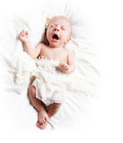 Geeuwende baby Stock Afbeelding