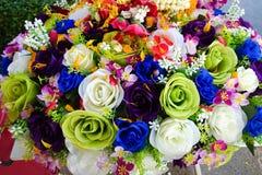 Gefälschte Blume und Blumenhintergrund stockfotografie