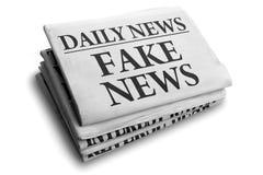 Gefälschte Nachrichtentageszeitungsschlagzeile stockbild