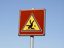 Gefahr des fallenden Zeichens Lizenzfreies Stockfoto