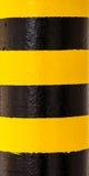 Gefahrenwarnung auf Säule Stockbild