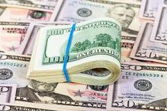 Gefaltete Dollarscheine Stockbilder