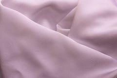 Gefaltete Gewebe mit reichen warmen Farben Stockbild