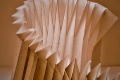 Gefaltete Papierzusammenfassung im Sepiaton stockfotos