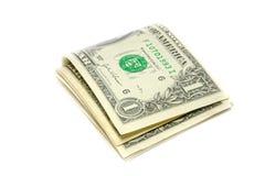 Gefaltete US-Dollar Rechnungen Stockbilder