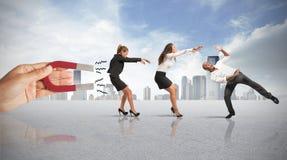 Gefangennehmen von Leuten mit Marketing Lizenzfreie Stockfotos
