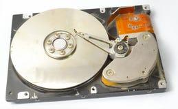 Geöffnetes gebrochenes Festplattenlaufwerk von der Seite Lizenzfreies Stockbild