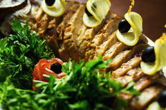 Gefilte fish,Gefilte fish on the plate closeup.Delicious stuffed. Carp with lemon.Fish carp stuffed.Stuffed fish with lettuce leaves Royalty Free Stock Photography