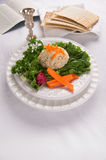 Gefilte Fish with Kidduch Cup, Matzah and Haggadah royalty free stock images