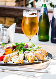 Gefilte fish, pike with vegetables and herbs, beer,restaurant Royalty Free Stock Images