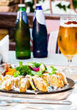 Gefilte fish, pike with vegetables and herbs, beer,restaurant Stock Photography