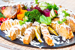 Gefilte fish, pike with vegetables and herbs, restaurant stock photo