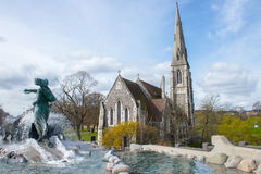 Gefion Fountain and St. Alban`s Church Royalty Free Stock Image