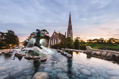 Gefion Fountain and St. Alban's Church in Copenhagen, Denmark. Stock Images