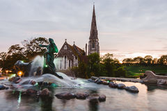Gefion Fountain and St. Alban`s Church in Copenhagen, Denmark. Royalty Free Stock Image