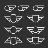 Geflügelte Ausweise und Embleme Stockfotografie