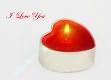 Geformte Kerze des Herzens mit Text Stockfotografie