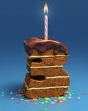 Geformter Geburtstagkuchen der Nr. drei mit Kerze Stockfotos