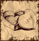 Geformter Kasten des Herzens auf Weinlesehintergrund Lizenzfreie Stockbilder
