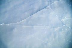 Gefrorene Eisbahnbeschaffenheit des Sees Stockfotos