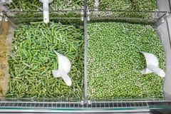 gefrorene Massenerbsen und Bohnen Stockbild