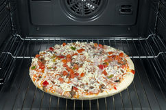 Gefrorene Pizza Stockbilder