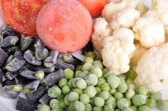 Gefrorene Tomate, Spargel, Erbsen und Blumenkohl Lizenzfreie Stockbilder
