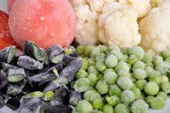 Gefrorene Tomate, Spargel, Erbsen und Blumenkohl Stockfoto