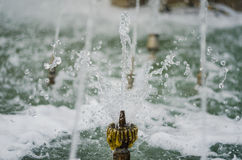 Gefrorener Wasserbrunnen klein Stockfotografie
