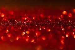 Gefunkelter roter Hintergrund - Weihnachten Lizenzfreie Stockfotos