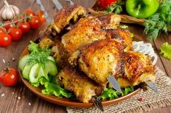 Gegrillt von den Hühnerschenkeln auf Aufsteckspindeln stockfoto