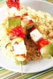 Gegrillte Aufsteckspindeln über Reis Stockfotos