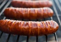 Gegrillte Schweinswürste lizenzfreies stockbild